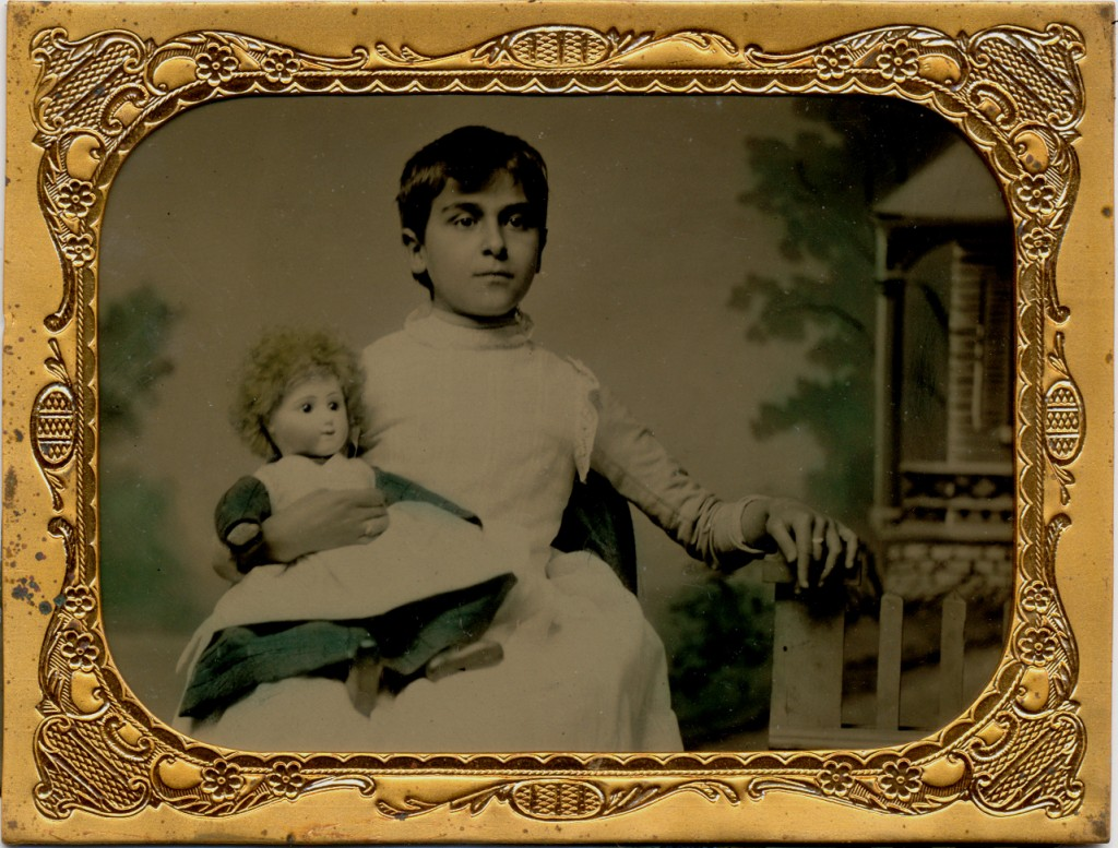 GIRL HOLDS DOLL WITH MISSING HAND